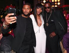 Pals: Usher (left) and Diddy (right) made a Naomi sandwich on Monday night as they helped her celebrate her  birthday at PHD Rooftop Lounge, New York