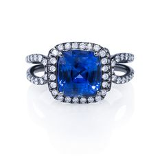 Stunning cushion-cut sapphire engagement ring with black rhodium details that enhance the dazzle of the pave diamond halo and band.