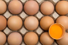 background of chicken eggs in a cardboard tray