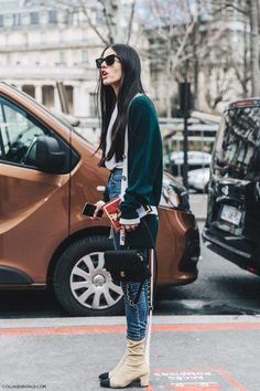 Gilda Ambrosio street style with grandma cardigan, t-shirt, skinny jeans, sock ankle boots and mini bag