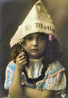 My great grandmother used to make these hats for me.  She also made dolls cut out of newspaper.