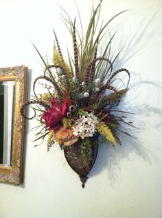 Gorgeous, extra-large wall sconces. By Greatwood Floral Designs.