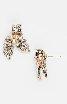 Free shipping and returns on Nina 'Abbey' Cluster Stud Earrings at Nordstrom.com. Eye-catching sparkle defines the foliage-inspired design of crystal studs berried with faux pearls.