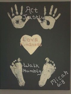 A canvas painting with the kids hand and foot prints. This is really neat, except would need to change it to KJV