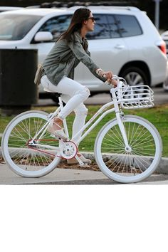 Even Alessandra Ambrosio's bike is embracing all-white for summer.   - HarpersBAZAAR.com