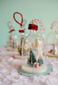 I absolutely love bell jars! My favorite holiday decorations are small vintage bell jar ornaments with sweet little snow scenes in them! I have been wanting to make some of these tiny cloche ornaments for a long while now, but have had a really hard time finding the little glass belljars anywhere.