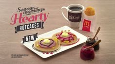 McDonald's Singapore now offers Hearty Hotcakes topped with chicken ham, American cheese, and a bizarre choice of hot fudge or strawberry syrup on top.