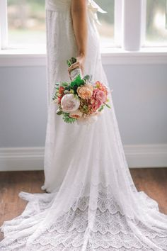 Like many wedding details, a bridal bouquet is often very sweet and romantic. For brides that really value having traditional flowers, this lush bouquet of peonies and roses is a perfect fit.