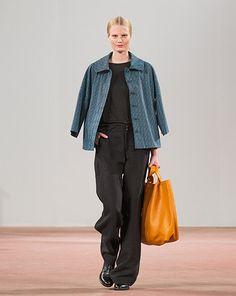 Black pants and shirt, turquoise jacket, yellow bag / Marimekko S/S 2015