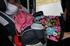 Car seat blanket - attaches to car seat lower buckle through a hole in the blanket, so it doesn't fall off.  Great idea!