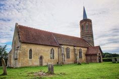 A few lonely headstones dot the garden at this abandoned church in Norfolk
