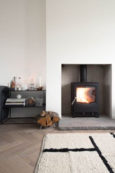 Installing a wood burning stove - a step by step guide — Design Hunter Wood Burner Fireplace, Stove Fireplace, Fireplace Design, Fireplace Hearth, Indoor Wood Burning Fireplace, Wood Burner Stove, Hanging Fireplace, Small Fireplace, Modern Wood Burning Stoves