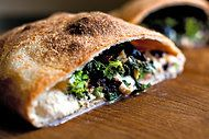 Broccoli Rabe, Olive, and Parmesan Calzone