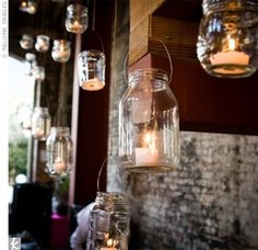 Candles in assorted clear hung jars as lanterns - can also easily tint glass in wedding colors (see Modge Podge glass tinting project on my DIY board)