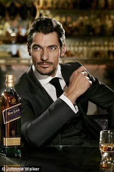Suave: Model David Gandy has swapped pants for a suit in his new campaign for Johnnie Walker Blue Label