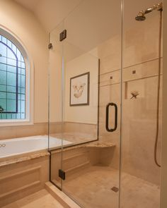 spacious standing shower along with large bath tub