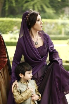 Queen Riana and-  O_O  We never gave Xander's father a name.  Oh wait....that would've been my job, wouldn't it? XD
