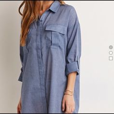 Textured pocket shirt dress cute and soft NWT A long-sleeved mini shirt dress crafted from a textured woven with a buttoned front, a basic collar, and chest flap pockets. Vented sides Unlined, woven 65% polyester, 35% cotton *brand new* Forever 21 Tops Button Down Shirts
