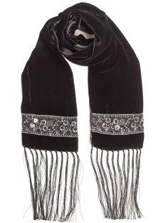 "Dress up your outfit with this luxurious long skinny velvet scarf with a beaded embroidered ribbon decorative detail on the ends. Lined with silk satin and finished with a 8"" hand knotted fringe."
