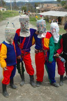 Kids in masks, Capac Raymi in Saraguro, Ecuador.