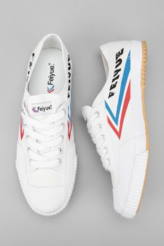 I love the detail - sure, it's a cute white sneaker but the red and blue chevron reminds me of vintage airline branding.