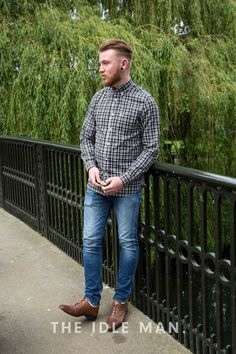 Men's Street Style | Casually Sharp - This look is simple and smart. Blue skinny fit jeans with a fitted checked shirt and a pair of formal shoes is all you need to nail this look. | Get the look at The Idle Man