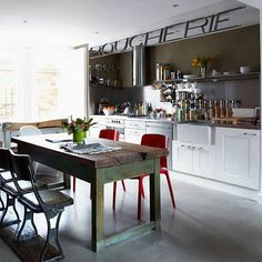 Love the rustic kitchen table and the polished concrete floor.