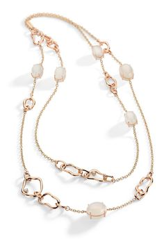 Necklace in 18k white and rose gold with round diamonds and white moonstone.