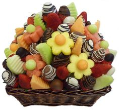 Fresh fruit in a basket made to look like a flower arrangement.  Great idea for celebrations, or perhaps a delivery on Valentines day.