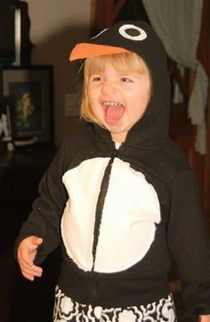 Easy penguin costume! take a basic black hoodie and sweat pants as the base of the costume and sewed on eyes, beak, and a belly. She made the feet so that they could be easily tied with a ribbon onto her everyday shoes.
