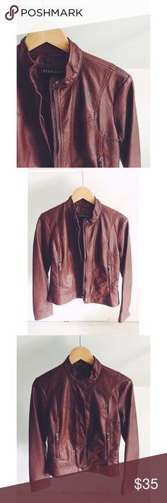 Bernardo cognac Vegan Leather Jacket Gorgeous, deep cognac coloring with a utility vibe...this is the perfect go-to leather jacket for your wardrobe! Made of Faux Leather, but super soft to the touch. Zips straight up the front and hits a little below the hips for the perfect, flattering fit! Gently used. Great condition. Bernardo Jackets & Coats Utility Jackets