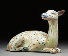 Ceramic figure of a reclining doe (side) .  17th century, Japan.  © Ashmolean Museum, University of Oxford