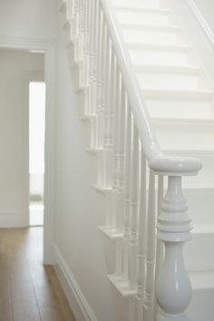 White banister on white staircase White Banister, White Staircase, Banisters, Stair Railing, Railings, White Hallway, Painted Staircases, Painted Stairs, Painted Floorboards