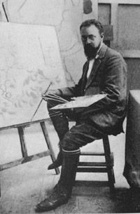 """Matisse in the autumn of 1911 in his studio at Issy-les-Moulineaux in front of his easel with Still Life with """"La Danse."""""""