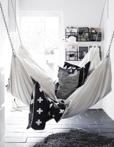= black and white throw, cushions and white hammock