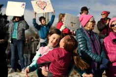 """Roxie 6, is swung by her older sister Kaija Stafford 8, as they dance after joining with over a hundred thousand people from across Colorado marched from Civic Center Park in downtown Denver during the """"Women's March on Denver"""" the day after the inauguration of President Donald Trump. January 21, 2017 Denver, CO."""