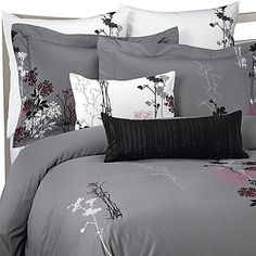 For completely seductive style, the Huntington duvet cover and accessories are embellished with embroidered flowers in shades of black, aubergine and fuschia over slate gray.