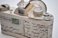 decorated camera (this resembled a flask at 1st glance...so now I need to decoupage a flask!)