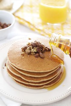 Whole wheat pancakes and pecan butter topped with glazed pecans