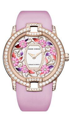 Blossom Velvet Watch by Roger Dubuis. The spirit of the Geneva‑based watchmaker shines through each detail of this timepiece, from the brilliant‑cut diamonds around the barrel, mother‑of‑pearl centre up to the Poinçon de Genève inscriptions. Ring Watch, Bracelet Watch, Luxury Watches For Men, Beautiful Watches, Violet, Cool Watches, Fashion Watches, Michael Kors Watch, Jewelry Watches