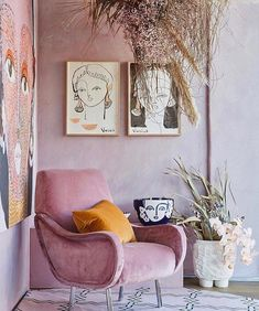 Pink mid century modern chair in a pink room