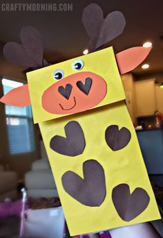 Paper Bag Giraffe Puppet Craft with Hearts for a Valentine's Day art project! | CraftyMorning.com Valentine's Day Crafts For Kids, Valentine Crafts For Kids, Animal Crafts For Kids, Valentine Day Crafts, Diy For Kids, Valentines Day Heart Shaped Animals, Giraffe Crafts, Paper Bag Crafts, Paper Bag Puppets