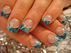 Nude base and blue glitter Nail Art