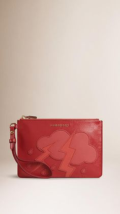 345d9b78db Burberry Coral Pink Patent Grainy Leather Appliqué Wristlet - Patent grainy  leather wristlet with graphic hand