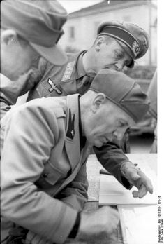 Benito Mussolini speaking with German generals. Italy, World War II, unknown town 1944
