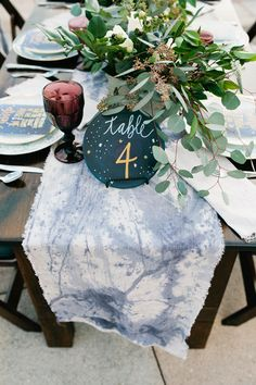 constellation table number - photo by Amanda Lenhardt http://ruffledblog.com/starburst-themed-wedding-inspiration #weddingideas #tablenumber #constellations