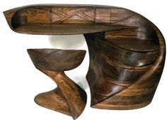 This sculptural desk and chair set is not only intriguing but also quite clever in design. This desk has many functional compartments: three lower drawers that pivot toward the seated user; four smaller, irregularly shaped drawers; two compartments and a secret drawer, all disguised behind the carving above the desk top. £80,682