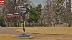 ❤ =^..^= ❤  Icicles cover a sculpture of a dancer in Tulsa's Municipal Rose Garden.