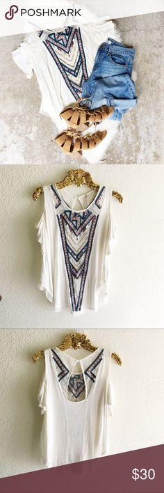 Free People Gypsy Spell Top A sheer knit panel, detailed with beads and multicolor embroidery lends this Free People blouse exotic appeal. The open back offers a glimpse of skin. A button closure secures the neckline. Short sleeves with shoulder cutouts.  Fabric: Burnout jersey. 85% viscose/15% linen. Free People Tops Tees - Short Sleeve