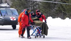 NHFG Conservation Officers rescue an individual. Buy your NH Hike Safe Card!